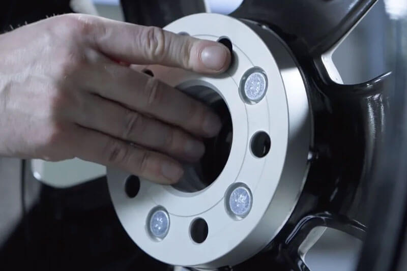 Check the wheel center bore for any play. The wheel spacer must fit firmly in place.