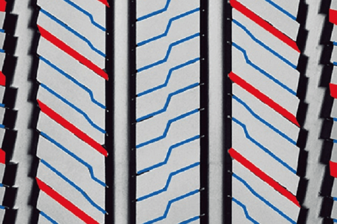 The elements of the tread pattern that speed up the water evacuation