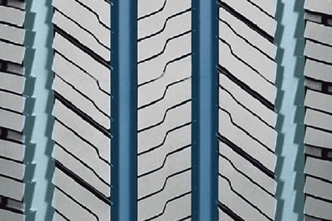 The grooves improving the tire's stability on snow (light blue) and on wet pavement (dark blue)